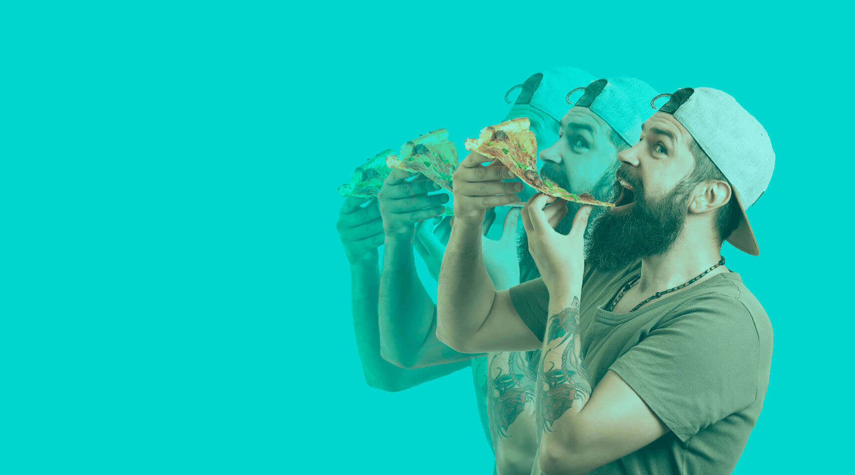 Bearded man about to take a bite out of large pizza slice