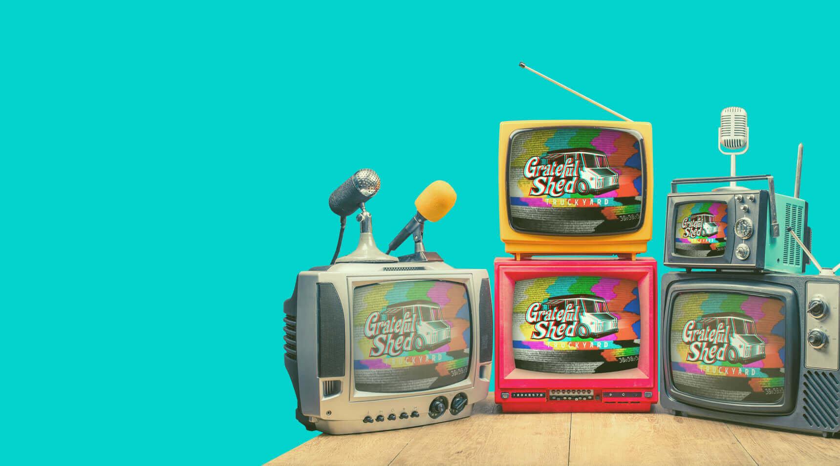 Retro TVs displaying the Grateful Shed Truckyard Logo